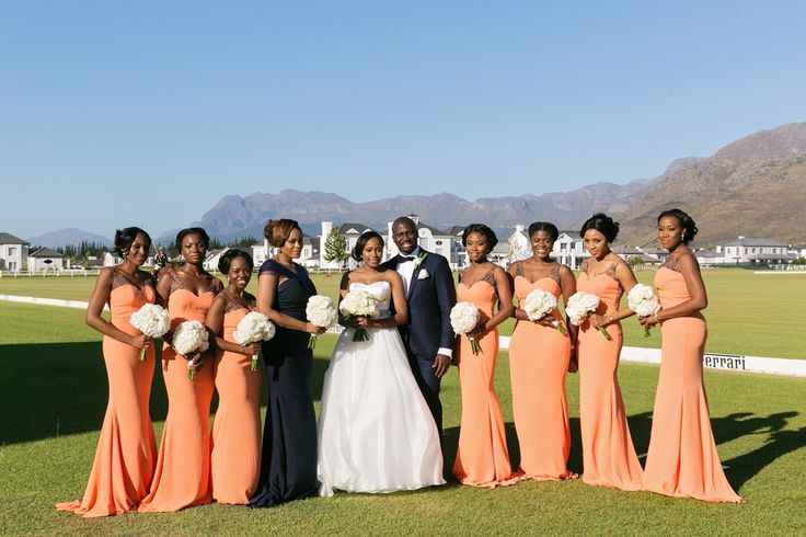 Opulent wedding. Black Tie wedding. Coral bridesmaids dresses. White rose bouquets. Image by ZaraZoo