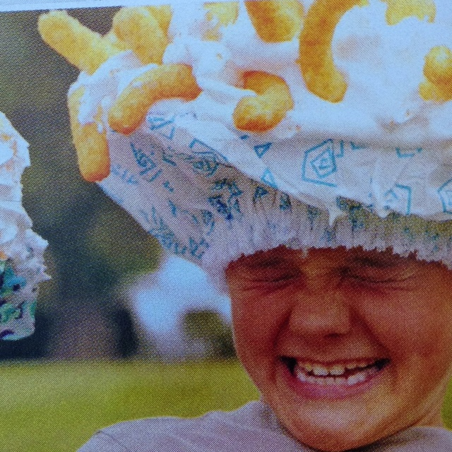 Cheese puff on shaving cream shower cap relay races.  Team with most wins.  Family fun mag