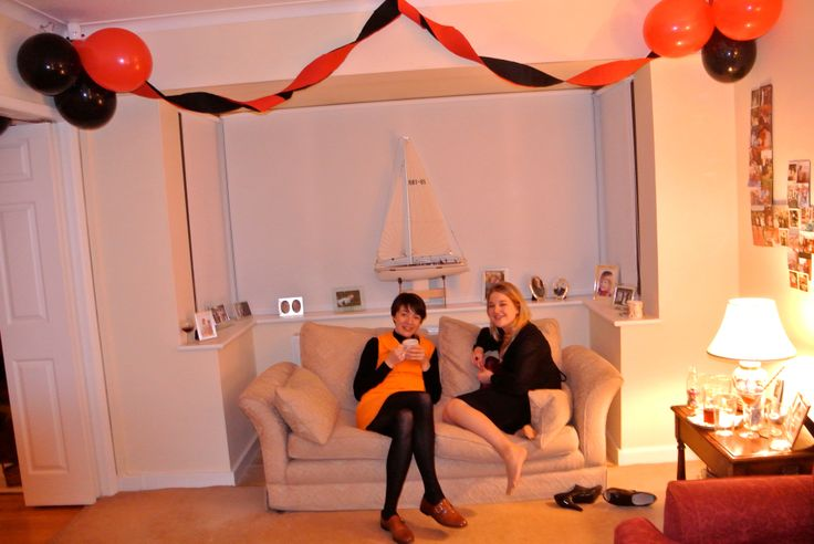 Crepe paper streamers with black and red balloons.