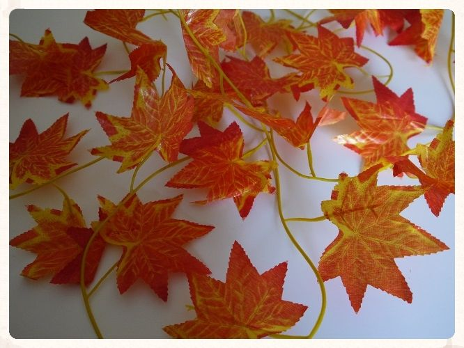 Autumn Leaf Garland. 2 5 metre long, only £2.99! This artificial autumn leaf vine is great for giving your wedding reception that autumnal feel. www.picketfenceweddings.co.uk