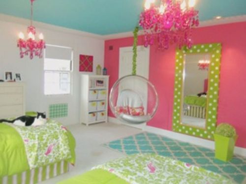 painted ceiling. hot pink accent wall. framed mirror. chandelier over each bed. love every detail!