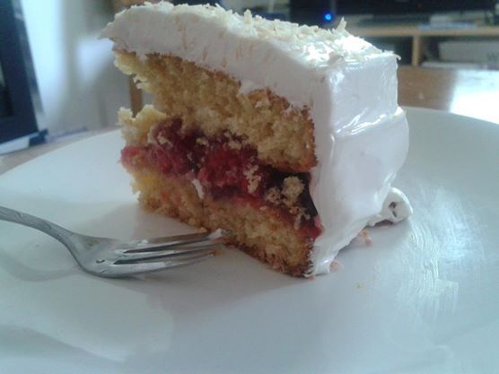 Snowball cake = coconut sponge, raspberries and jam filling, and marshmallow frosting