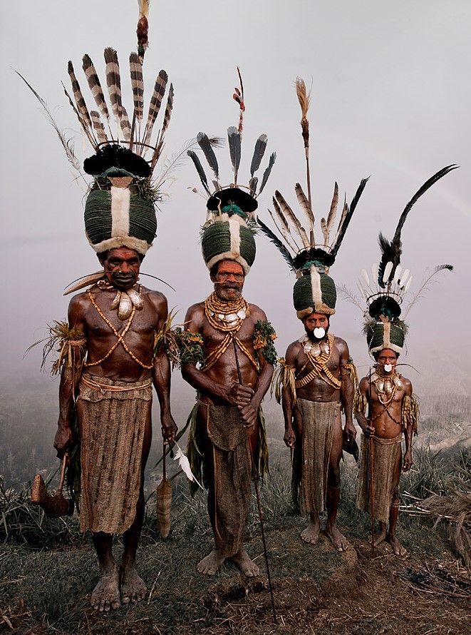 """Papua New Guinea - Kalam tribe - in Jimmy Nelson's photo serie """"Before they pass away"""". The women are exceptional farmers. The men hunt and fight other tribes over land, pigs and women. Great effort is made to impress the enemy with terrifying masks, wigs and paint."""