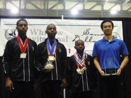 Jamaican Gymnasts from left: Jamin Melbourne Levy, Daniel Williams and Jiovannua Jackson and coach Shin Nishida posing at the 12th staging of the Whitlow Invitational for men in Orlando, FL: Coach Shin