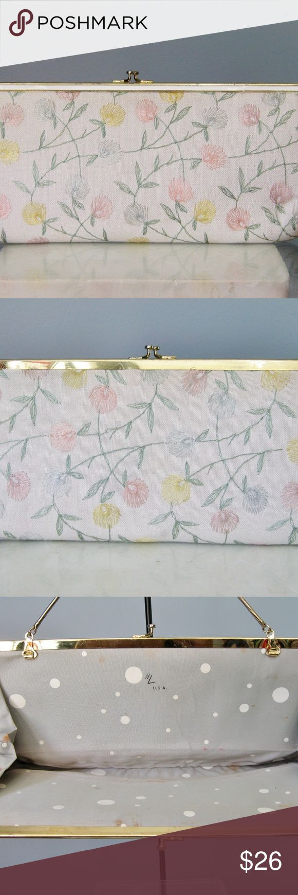 "Vintage 1960s Embroidered Clutch Extra pretty long and lean clutch from ""HL USA,""  a.k.a. Harry Levine Corporation. Gold chain that can be tucked away inside the bag or slung over your arm for hands free mingling. White fabric exterior covered w delicately embroidered clover flowers in pastel colors, pink, blue and yellow. Interior has a gray fabric lining with big white polka dots. Gold-tone kiss-lock frame Attached change purse I love the long slim chic shape of this bag. 12.5"" x 8"" x 1.5""…"