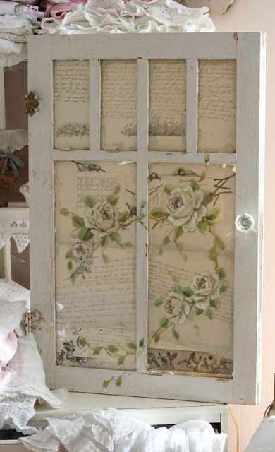 This old door has the glass missing but a new backing of wallpaper, gift wrap or book pages turns it into a beautiful wall hanging. Using cork on the back side can make it pretty and useful too.