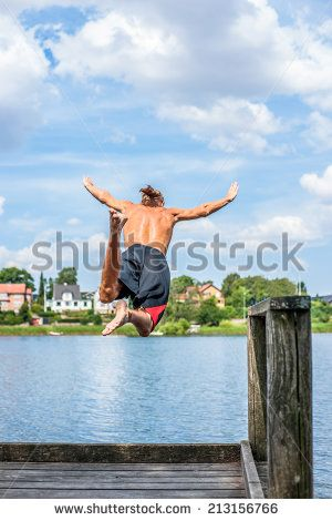 Man Jumping Into The Water From A Pier Lagerfoto 213156766 : Shutterstock
