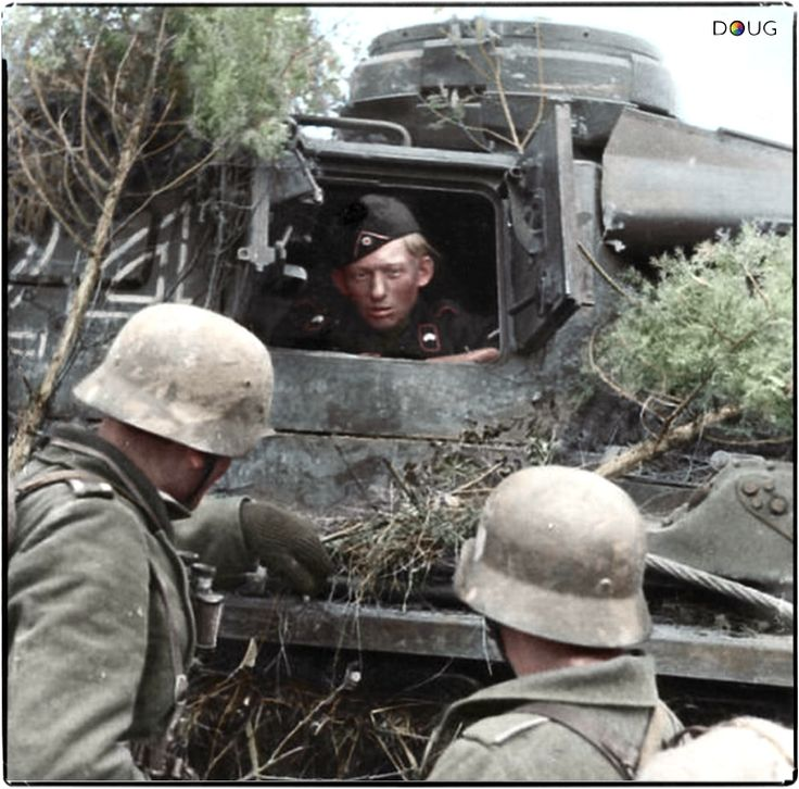 A crew member of a Panzer Mk. III Ausf.J chats to two Grenadiers possibly part of the 38. Korps, 16. Armee which was to the north of Novgorod where it occupied positions on the southern side of the Volkhov salient, which had come into being as a result of the Soviet offensive in January 1942. c. Spring 1942.