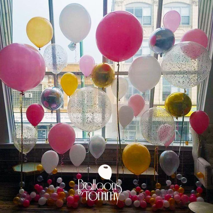 Super cute pink and gold balloon wall