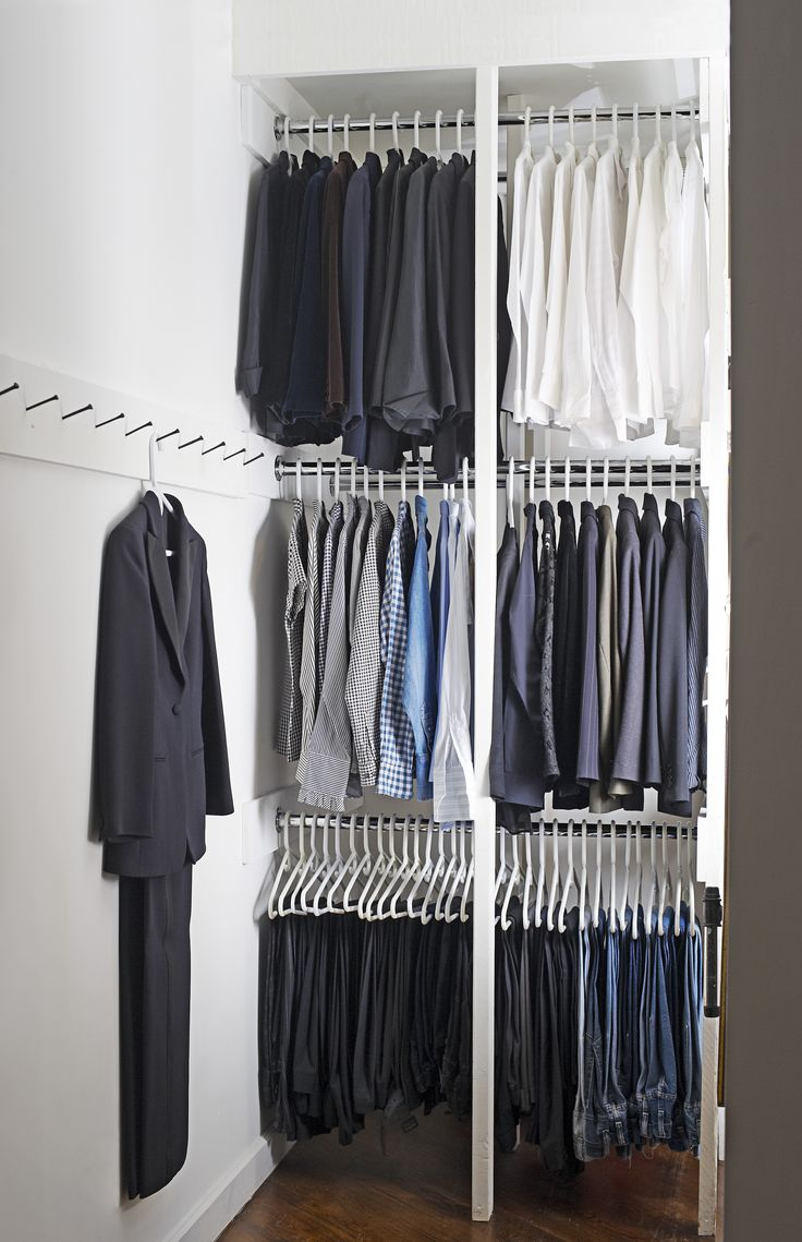 "Whatever your closet space, Peri Wolfman advises ""potentializing all the storage possibilities"" by making use of multiple levels (these racks are two bars deep), placing shelves over doors, and putting hooks on bare walls."