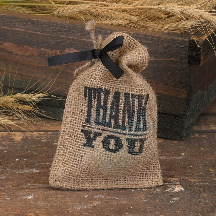 """Give thanks with this burlap party favor bag with twine drawstring closure and black typography with """"Thank You"""" design."""