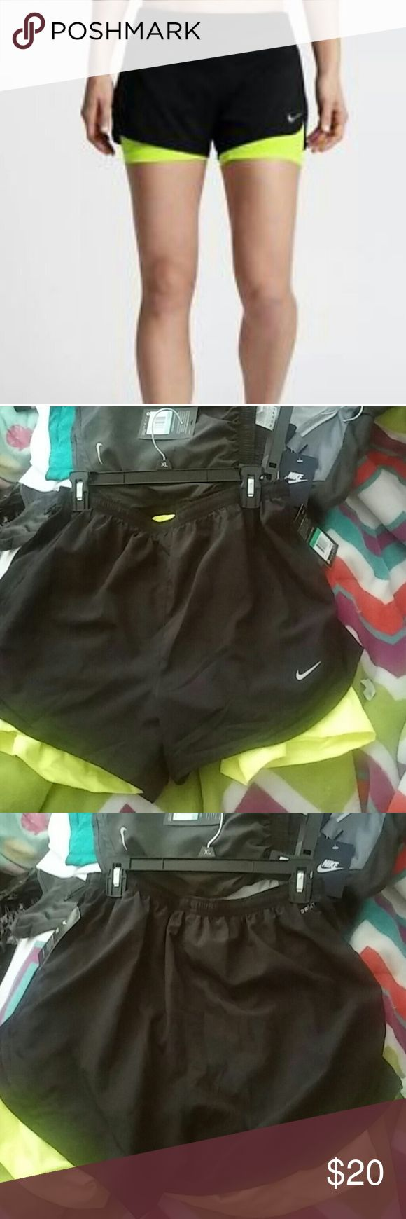 Nwt nike 2 in 1 running shorts This is a new pair of women's Nike two in one running shorts black with bottom neon yellow shorts Nike Shorts