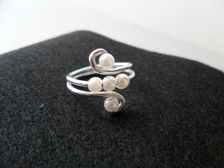 Wire And Pearls Ring - neat idea to try for Sarah's next jewelry set. Maybe not pearls, but the marble nuggets or colorful crystals?