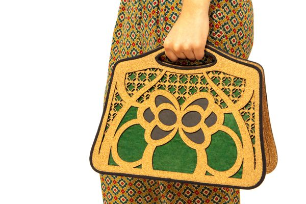 "Eco-friendly handbag ""Farfalla"" with model, via Behance"