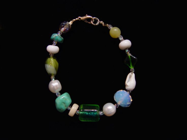 "Glass, Turquoise, and Czech crystal Bracelet.  By Debbie Aldrich. 7.5""."