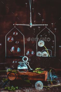 Medical scales with dandelion seed and soap bubbles