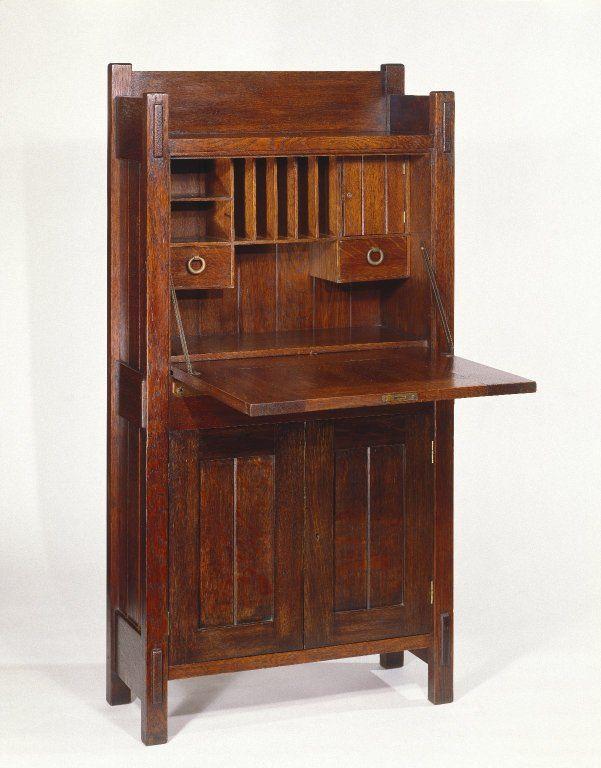 Gustav Stickley (1857-1942). Dropfront Desk, Open Medium: Oak with copper hardware Dates: ca. 1903