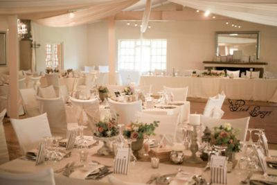 Guest tables: Vintage flowers & decor. Hertford Country Hotel, Johannesburg. Floral Design by www.pinkenergyfloraldesign.co.za