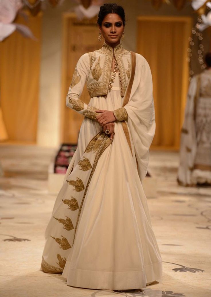 Model walks the ramp in cream floor length anarkali matched with embroidered shrug for Rohit Bal at Indian Bridal Week 2013