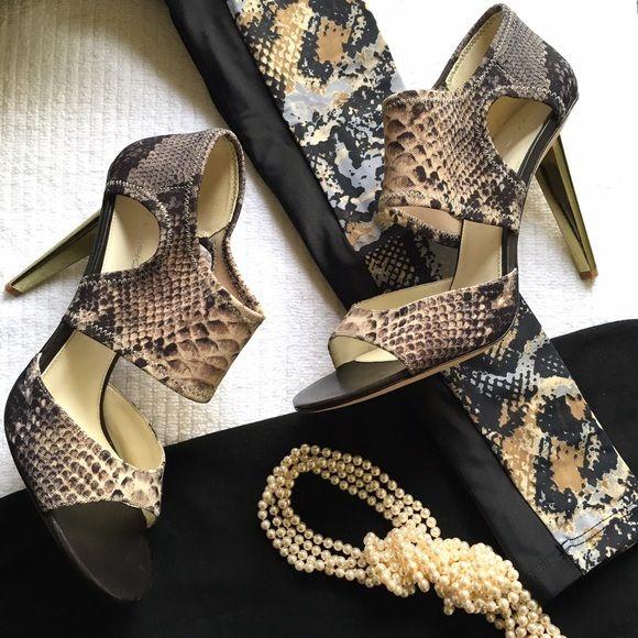 """Via Spiga open toe animal print heels New in box. Designed in Italy. Elastic Fabric upper. Leather linning and leather sole. Animal print with black, browns tan and almond. 3 1/2"""" heel Size 10 medium Gold heel Dirty soles from trying on. Light few scratches on heels Via Spiga Shoes Heels"""