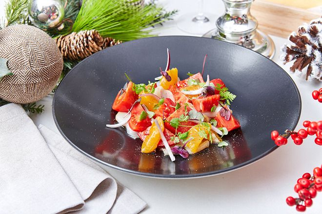 Salad with smoked halibut, mandarins, red onion and cilantro leaves