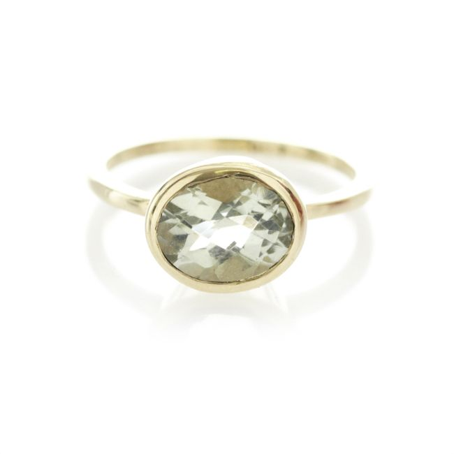 A 9ct yellow gold ring, with centered green amethyst gemstone.  When ordering one of our gold luxury rings please provide us with your exact ring size. This can be done in thecomment box once your order has been placed.   To find out more about ring sizes please visit the information page on the menu above.   Our luxury gold rings are only available to ship within South Africa.
