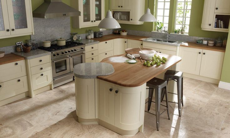 My absolute 100% dream kitchen! Shaker cabinet, round wooden handles, wooden worktops mixed with granite