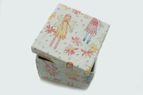 DIY fabric-covered boxes    Materials needed for your DIY fabric-covered box    Cardboard box with lid  Woven cotton fabric with little or no vertical, horizontal or diagonal stretch  Cardstock paper  Fabric scissors  Heavy-duty double-sided tape  Clear packing tape