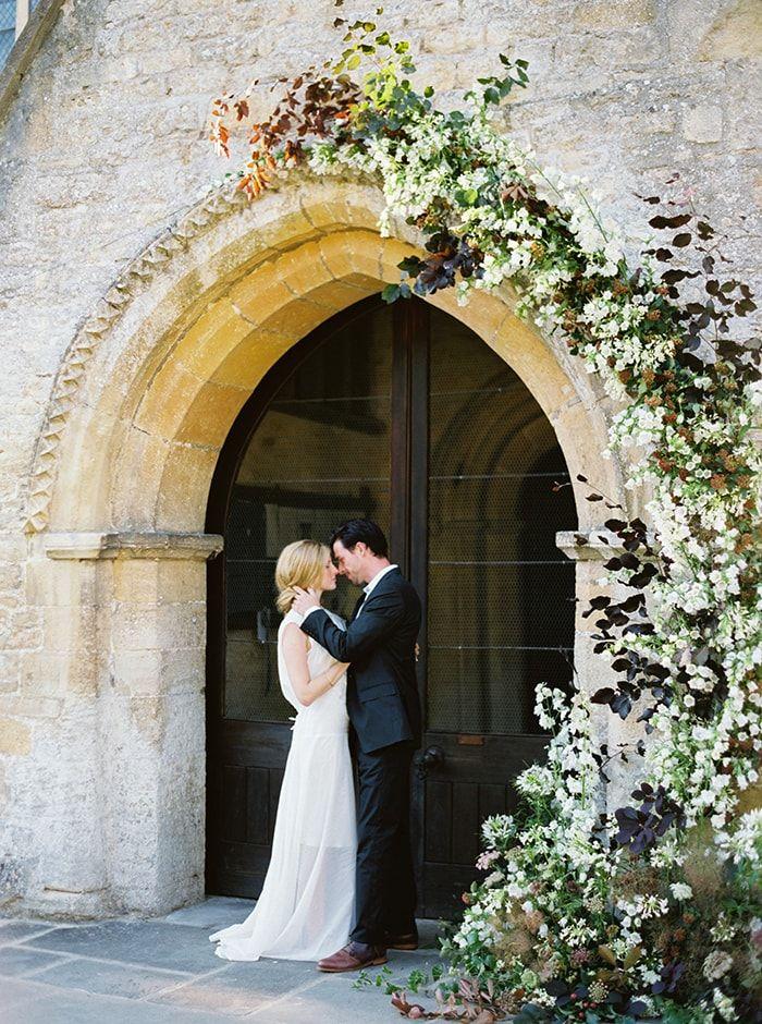 A vine-link and asymmetrical wedding arch.
