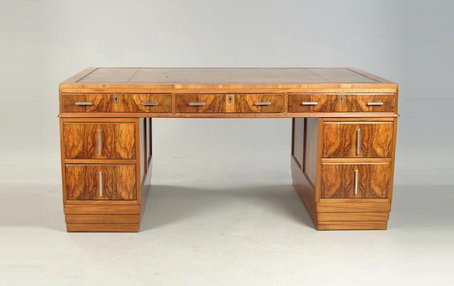 An Art Deco walnut partners desk