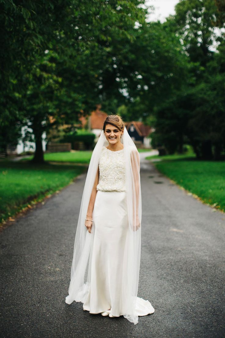 A Ritva Westenius Gown for a Glamorous Black Tie and Back Garden Wedding. Photography by Richard Skins