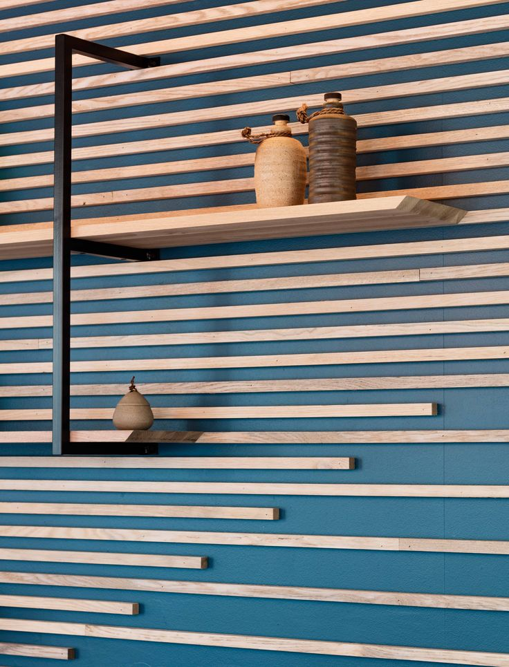 Karma Sushi, Aarhus, Denmark. Three natural core materials and a deep Scandinavian blue gives a Nordic atmosphere that is combined with a Japanese tranquility elegance.