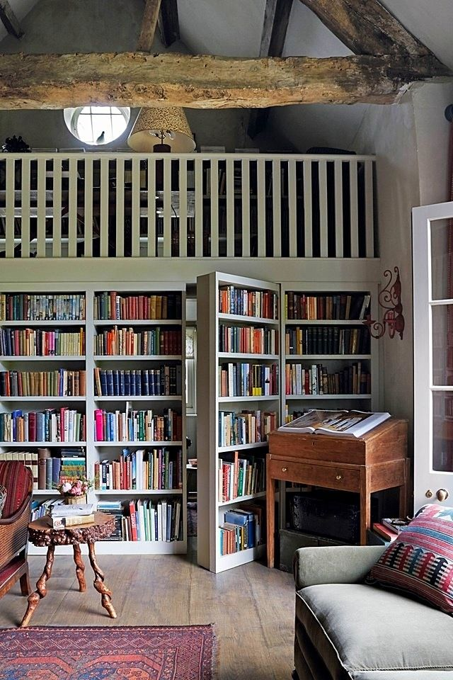 This cozy guest cottage, a converted English barn filled with antiques and encircled by bookcases, might just be your dream home.