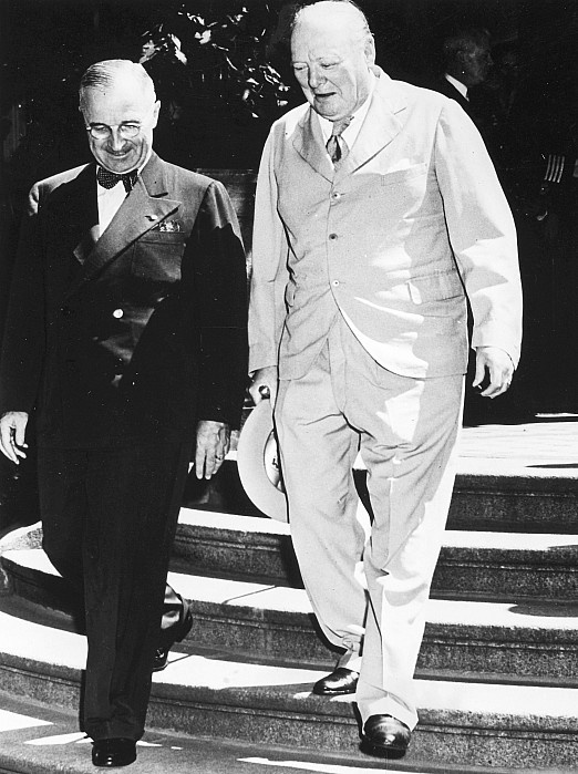 POTSDAM CONFERENCE, 1945. President Harry S. Truman of the United States and Prime Minister Winston Churchill of Great Britain descending the steps of the President's residence at Potsdam, Germany, July 1945.