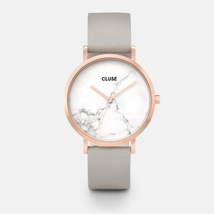 CLUSE La Roche Rose Gold White Marble/Grey -- Designed as a tribute to one's uniqueness, this CLUSE La Roche watch features a genuine white marble dial, produced from a raw stone. Every piece of marble is one of a kind with a natural veining pattern, which makes each La Roche timepiece entirely unique. Loyal to our minimal aesthetic, this collection features a 38 mm stainless steel case with a brushed rose gold finish and a grey leather strap for a bold and stylish look.