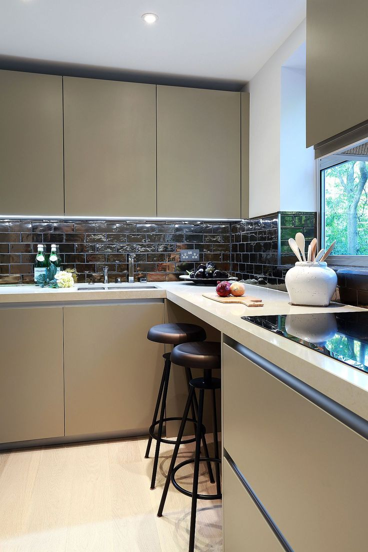 Revamped kitchen space on the second level with a glittering backsplash