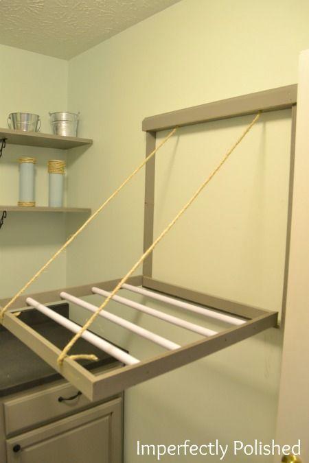 DIY Pull Down Drying Rack, 20 Laundry Room Organization Ideas via A Blissful Nest