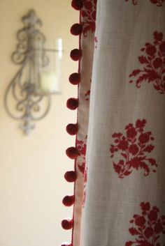 kate forman. Red and white curtains with red bobble trim