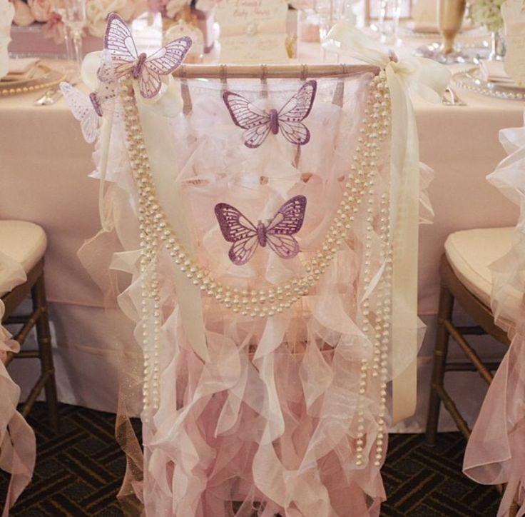 These butterfly chair linens are perfect for a sweet 16 or bridal/baby shower!