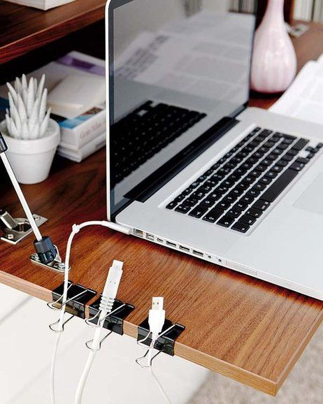 Binder Clips To De-Tangle Cords Clip binder clips to the side of a desk to hold USB and other cables. Thread through the metal part to keep cords tangle free.