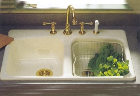 Kohler Brookfield enamel kitchen sink, brass fixtures & drains, wire rinse basket.