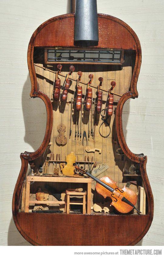 Cute! A violin shop inside of a violin.