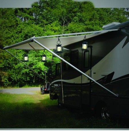 Use solar lights for camping! attach hanging ones to your umbrella.. ground ones fit in the spaces in your picnic table!