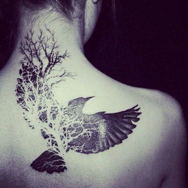 We are all part of this world. Tree and bird tattoo.