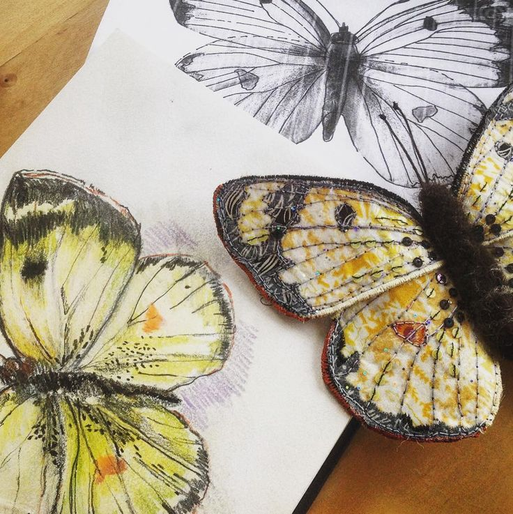 How it's made, today's challenge for #marchmeetthemaker . This picture shows the butterfly starting in my sketchbook, the pattern and the finished Clouded Yellow. The bits in between include layering fabric, reverse appliqué, free motion embroidery, hand beading and needle felting. A process that takes between 4 and 8 hours depending on the size and complexity. #freemotion #marchmeetthemaker #meetthemakers #howitsmade #mycreativelife #sketchbook #applique #embroidery #embroideryart #stitcher…