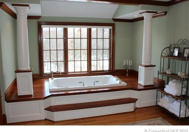 "Craftsman Master Bathroom with High ceiling, Hardwood floors, Columns, Kohler - Mariposa 66"" x 36"" drop-in VibrAcoustic Bath"