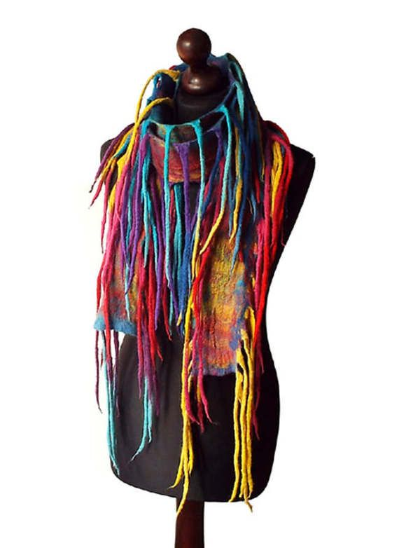 Felted scarf/ necklace made from finest Australian merino wool and hand dyed cotton gauze. Colors: multicolor - shades of yellow, shades of red, shades of turquoise, shades of blue, fuchsia, purple.  Size: length: 203cm (79,92); with fringes 260cm (102,36) width: 8cm (3,15) + fringes  Visit my fan page on Facebook: www.facebook.com/pracownia.artystyczna.arteduo  More scarves you can find here: www.etsy.com/shop/MarlenaRakoczy?section_id=14901313&ref=shopsecti...