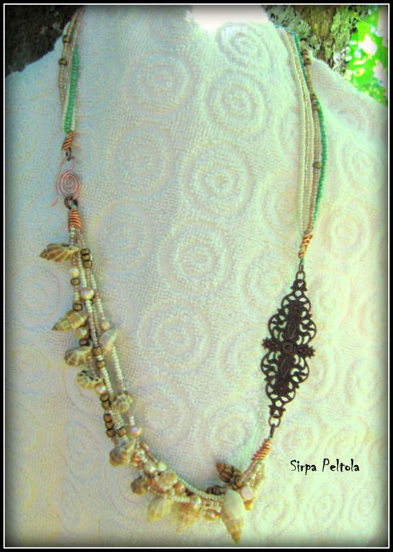 """""""Kuparisia Kuohuja"""" ,  """"Copper Waves"""" Necklace made of seed beads, some fresh water pearls, shells and antique copper tone filigree finding. And clasp is self made from copper wire, hoping it will darken on its own."""