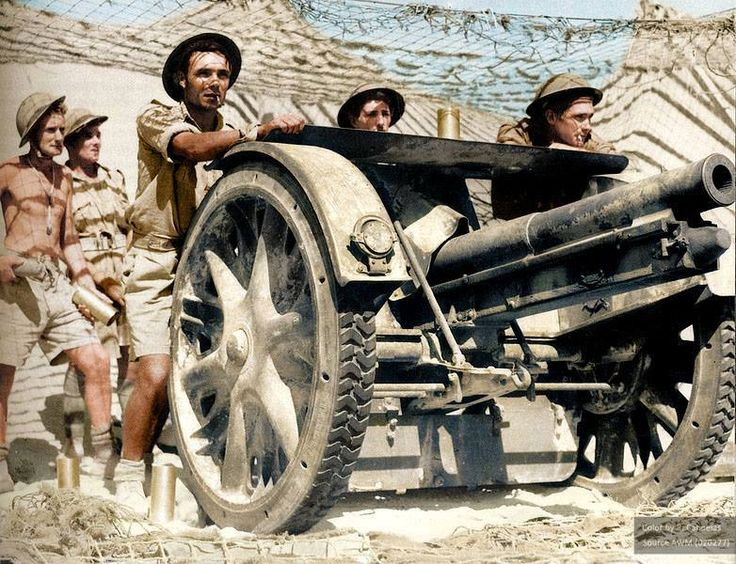 "El-Adem Sector, Tobruk, Lybia, August 27, 1941. Men of D Company, 2/17th Infantry Battalion using a captured Italian field gun to send 75mm shells back to their former owners. They were known as the ""Bush Artillery"" because they were converted infantrymen using captured guns. They came to symbolize the desperate courage, and the resolve of Tobruk's defenders during the siege of 41."