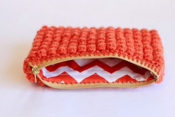 How to add a zipper and a lining to a crochet clutch.